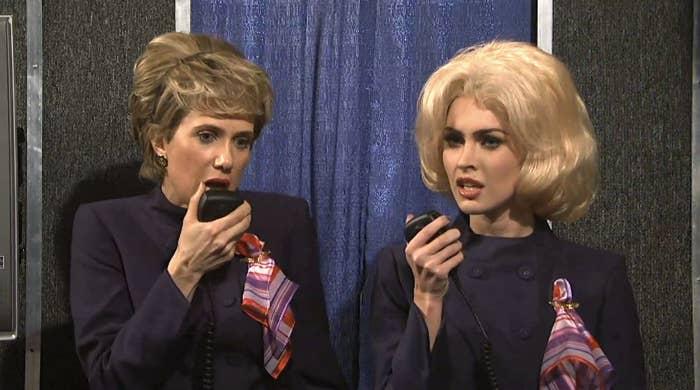 """Two people dressed as flight attendants in an """"SNL"""" sketch"""