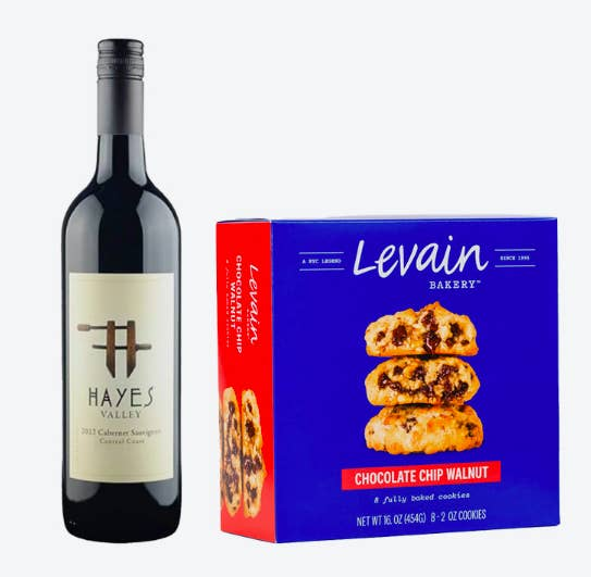 A bottle of wine and box of chocolate chip cookies