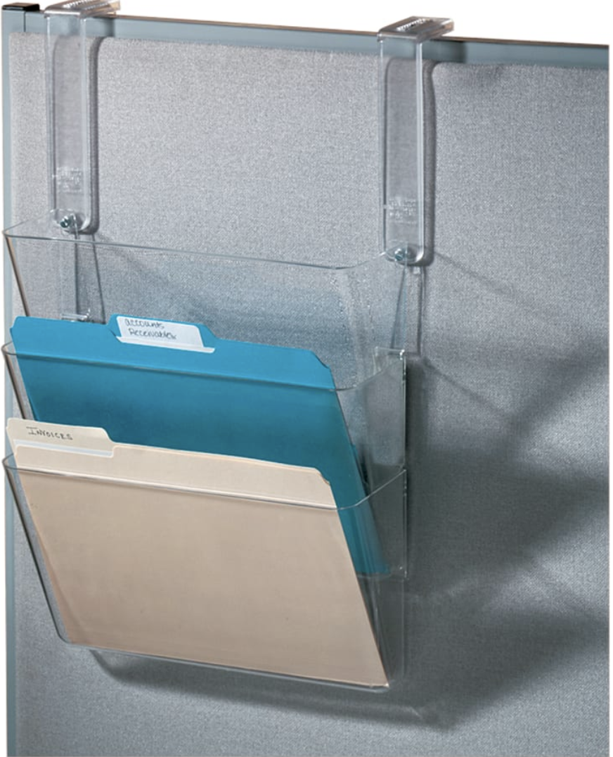 Transparent hanging folder organizer with three slots hanging from the side of a desk
