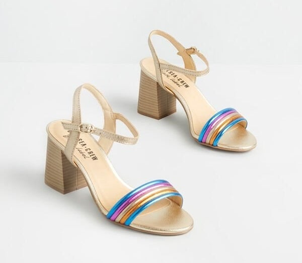 the stacked heel sandals with gold ankle straps and pink, gold, blue, and orange toe straps