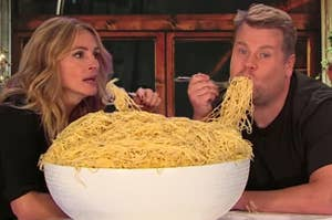 Julia Roberts and James Corden eating a giant bowl of pasta together