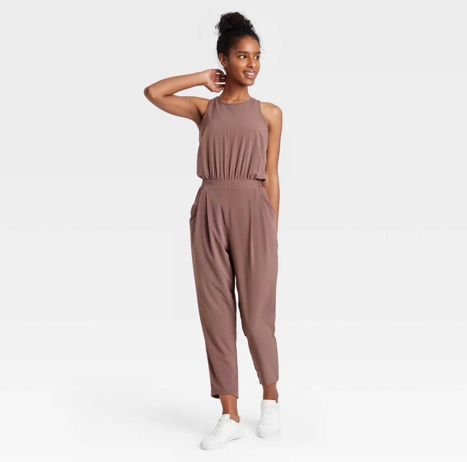 Model wearing the jumpsuit in brown
