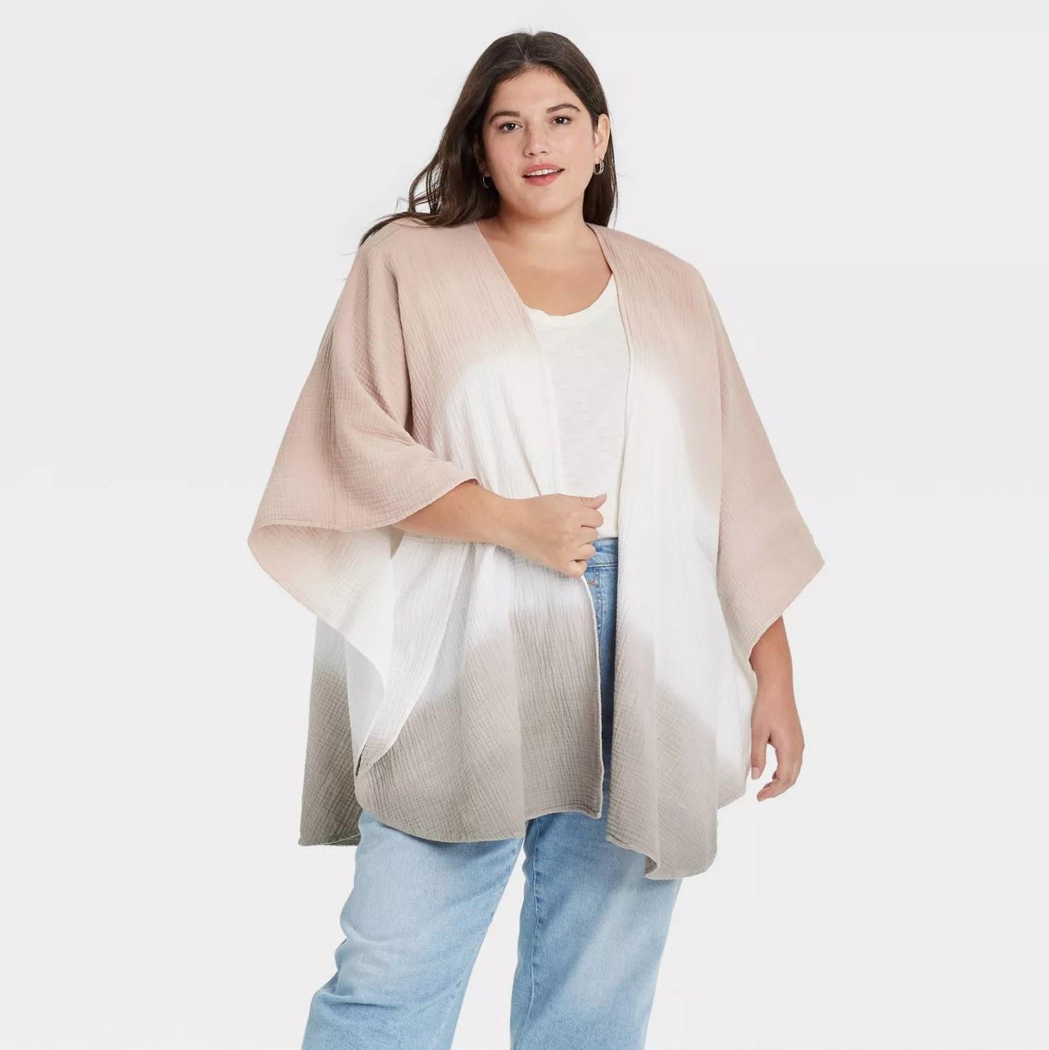 Plus-sized model wearing the jacket in neutral