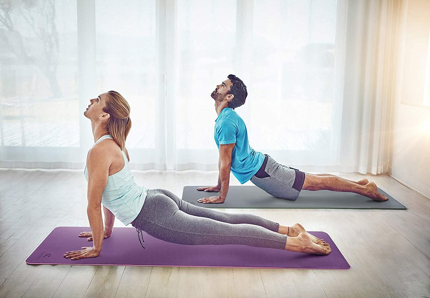 two people doing yoga on non slip yoga mats