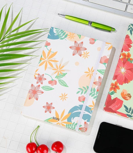 Two vibrant journals on a desk