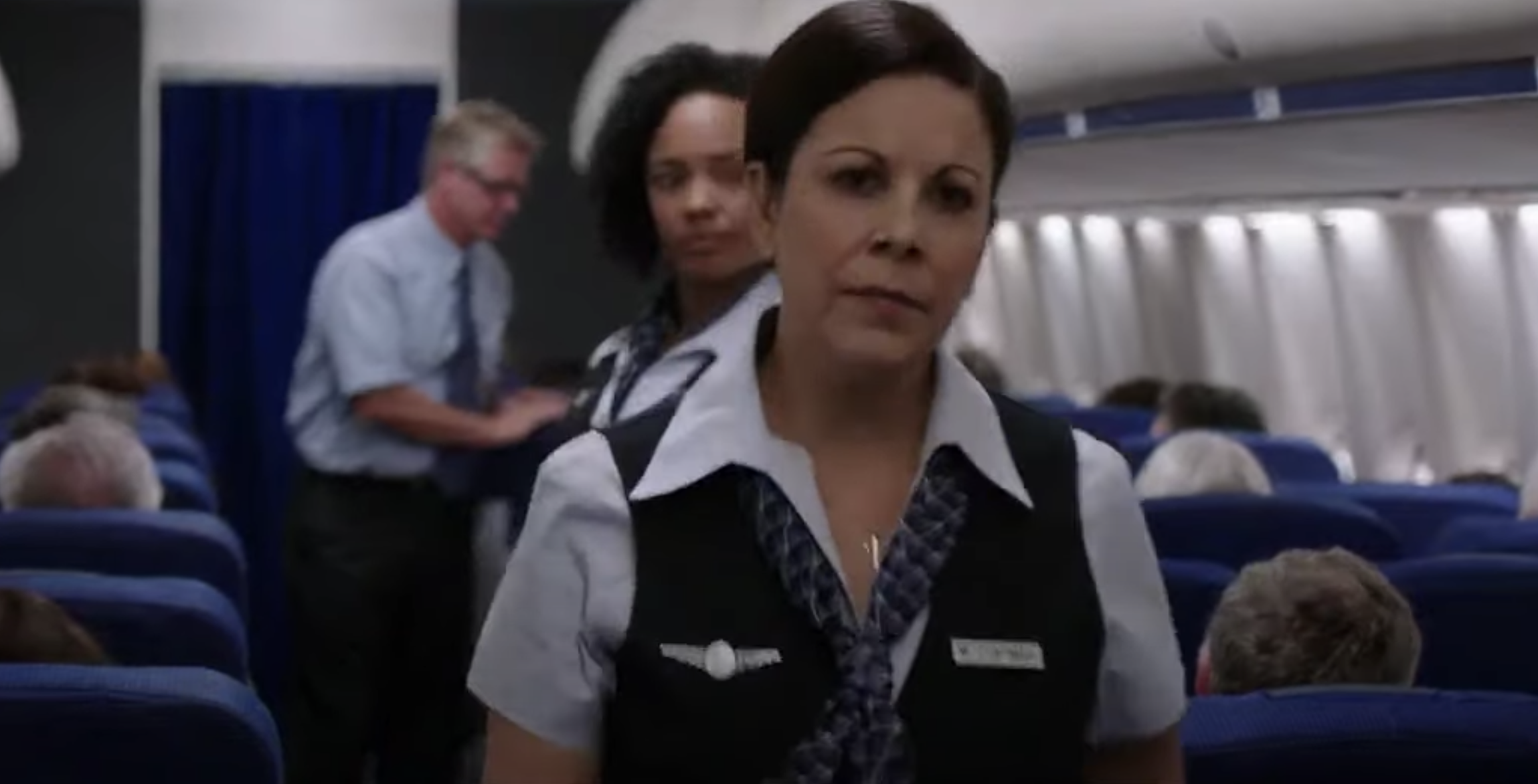 """A flight attendant looking disapprovingly in """"We're the Millers"""""""