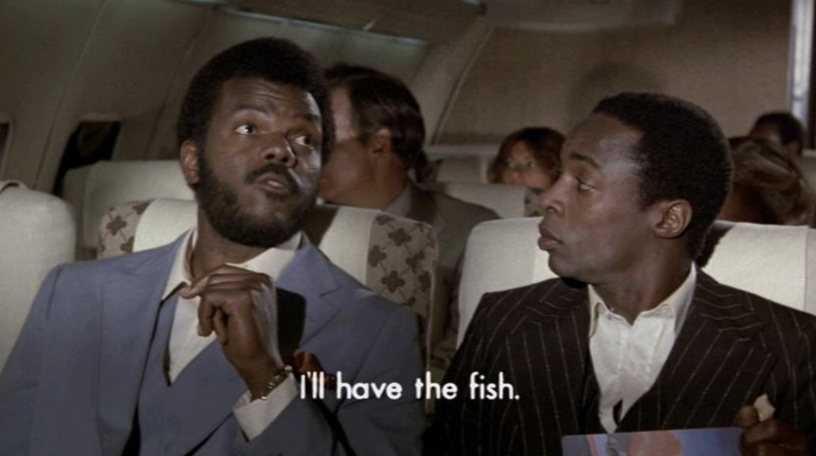 """Two men ordering their meals on a flight in the movie """"Airplane!"""""""