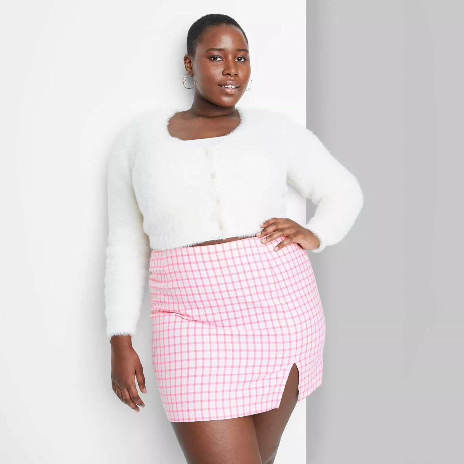 Plus-sized model wearing the skirt in pink