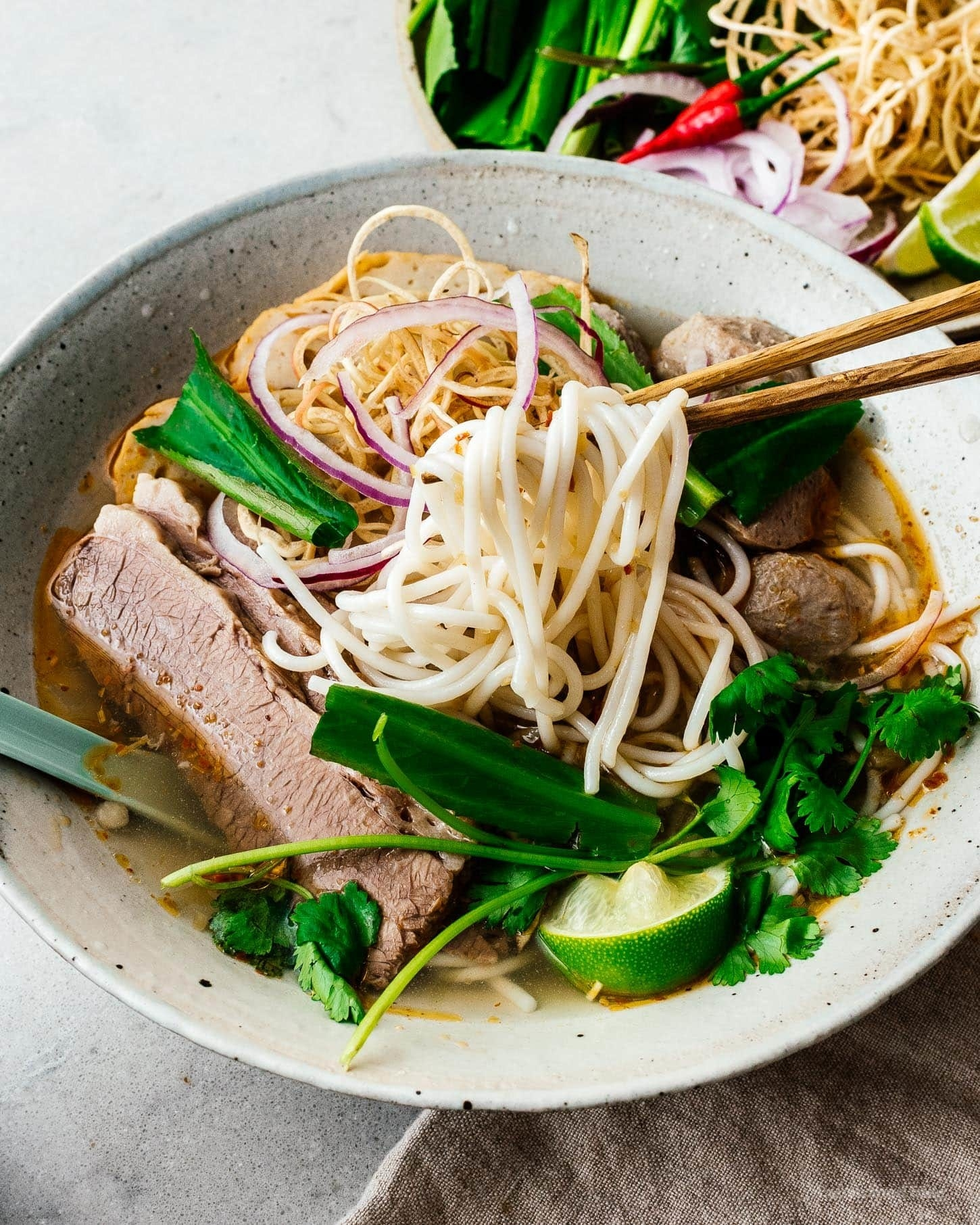 A bowl of Vietnamese beef and pork noodle soup.