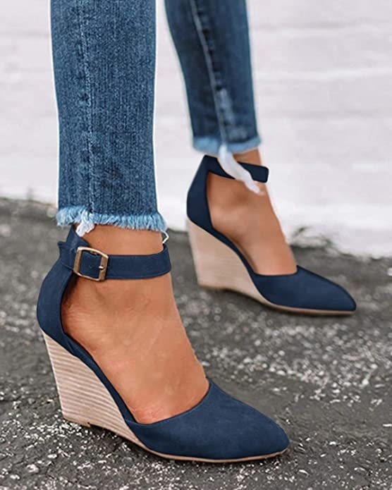 model wearing dark blue canvas shoes with a thick strap and pointer toes