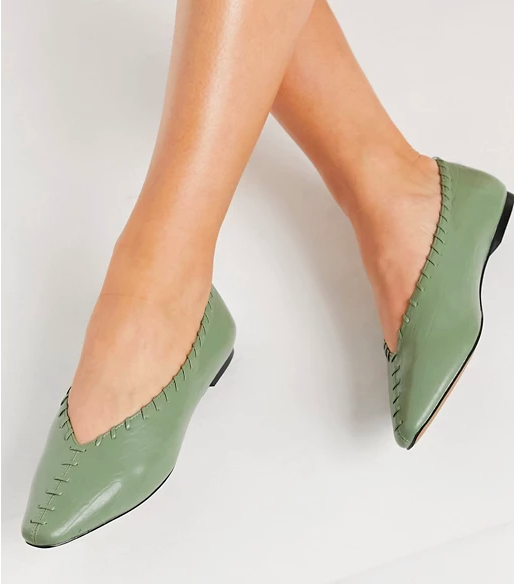 model wearing the green flats