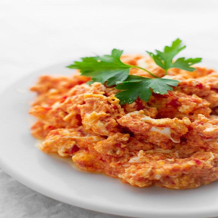 Greek scrambled eggs with tomato and feta.