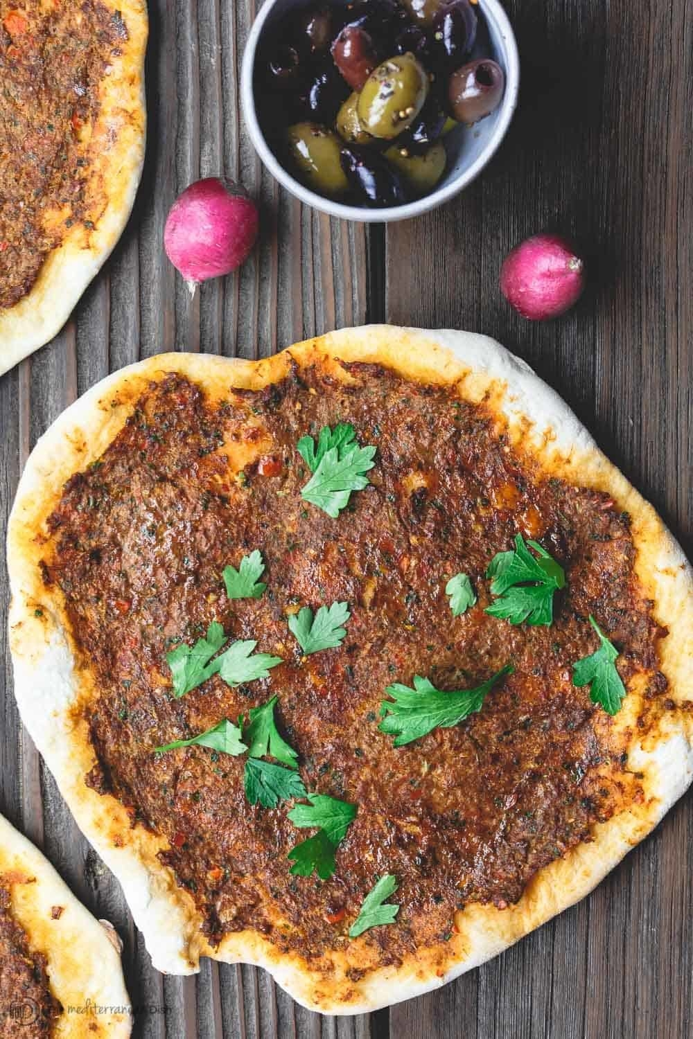 Lahmajoun, an Armenian thin-crust flatbread topped with spices.