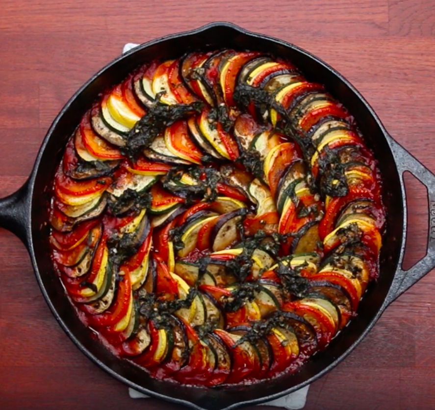 A cast iron skillet filled with ratatouille.