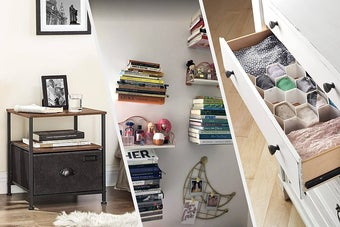 A small table beside a bed with books and water on the top, A bunch of floating shelves mounted to a wall with stacks of books balanced on them, An open dresser drawer showing neatly folded clothing