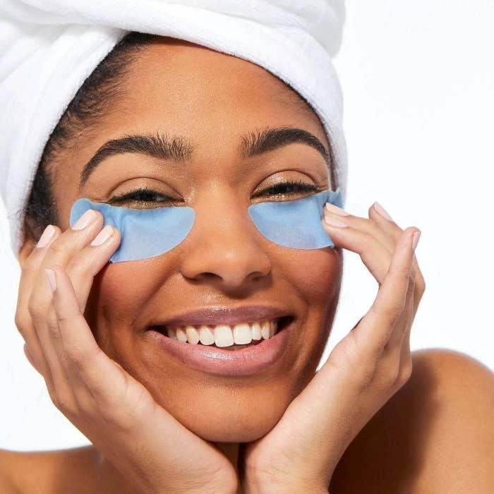 Blue under eye masks on a model's face