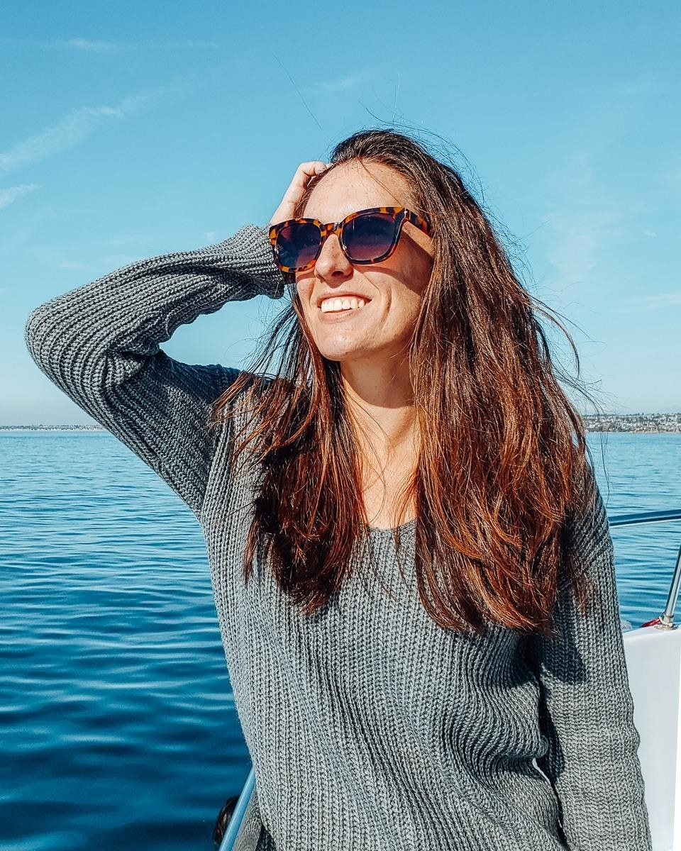 image of reviewer wearing the Tortoise Frame/Gradient Brown Lens sojos classic square polarized sunglasses out on a boat