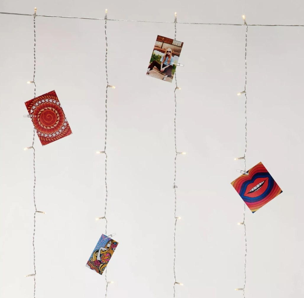 The curtain of lights with photos pinned to the strings