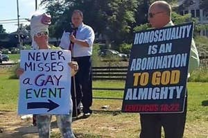 A counter protestor at an anti-gay rally holds a sign saying: they never miss a gay event