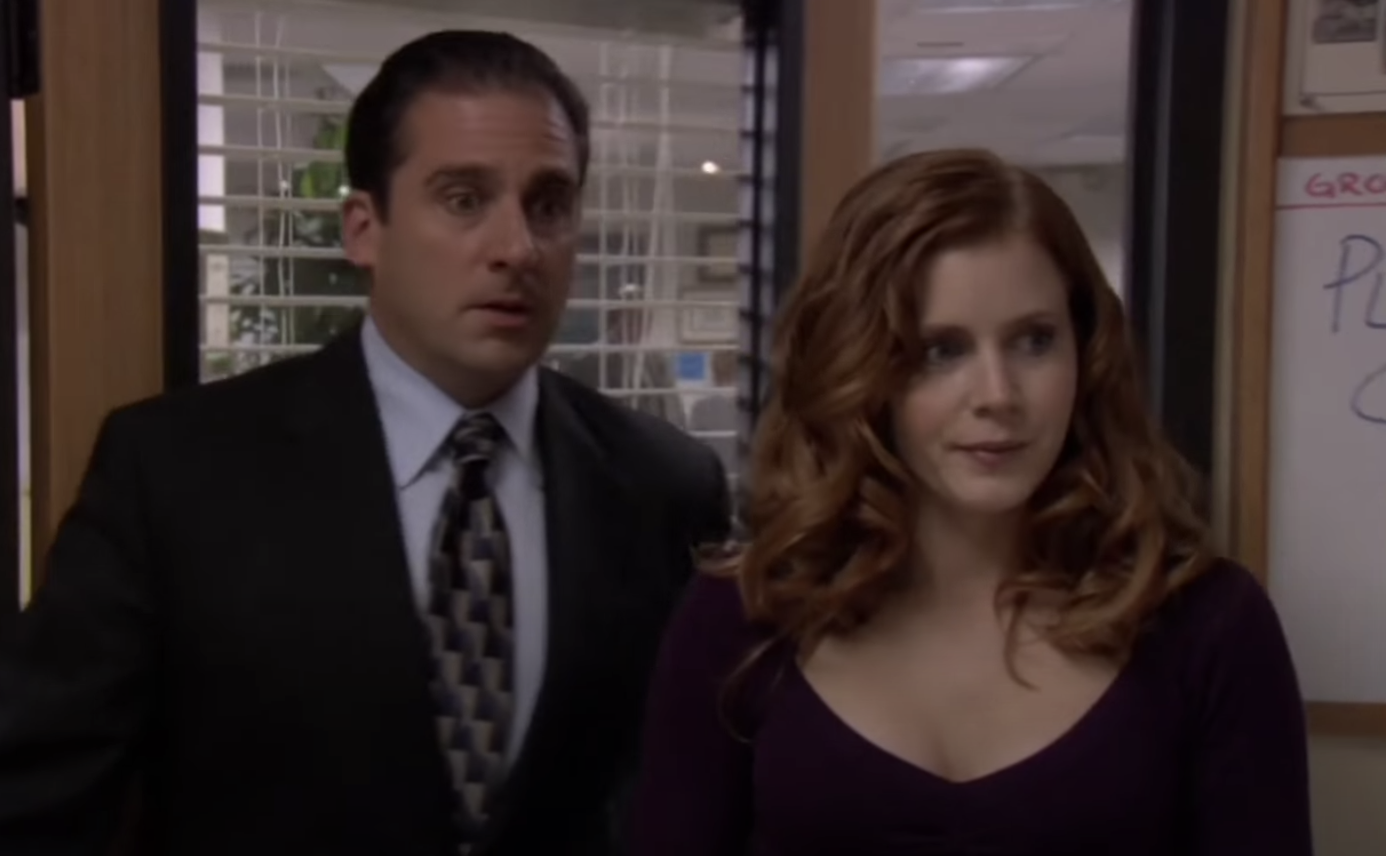 Amy next to Steve Carell as Michael