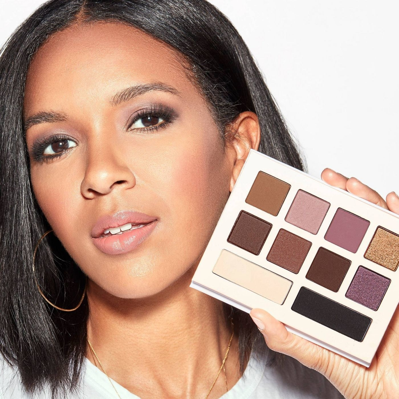 A model holding an eyeshadow palette