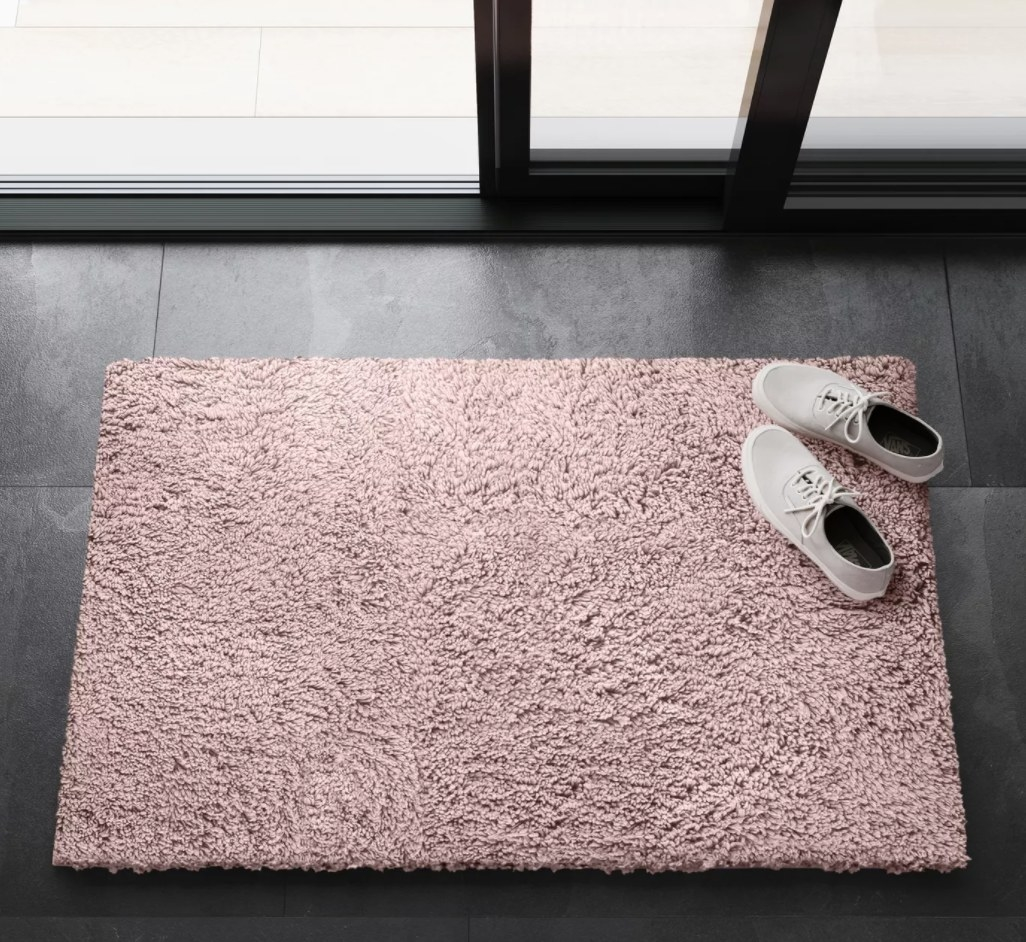 The rug in pink by a sliding glass door