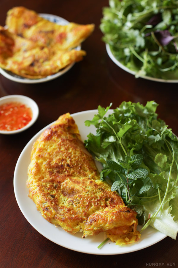 A Vietnamese rice flour crepe with herbs on the side.