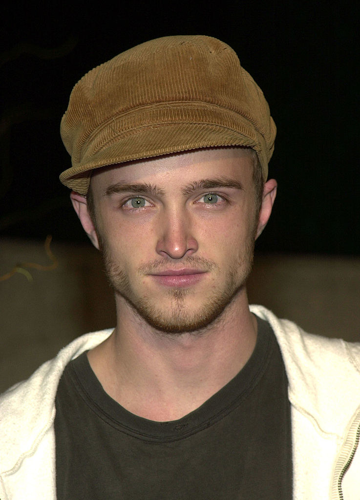 Aaron Paul in a corduroy newsboy cap