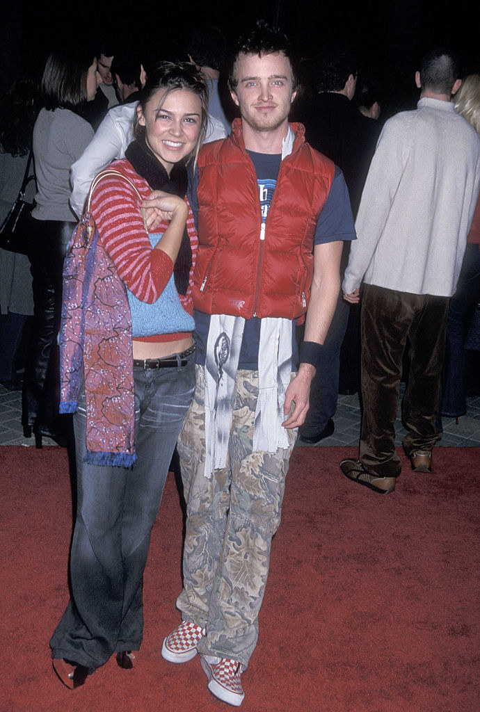 Aaron Paul wearing a puffy vest and all umatching clothing