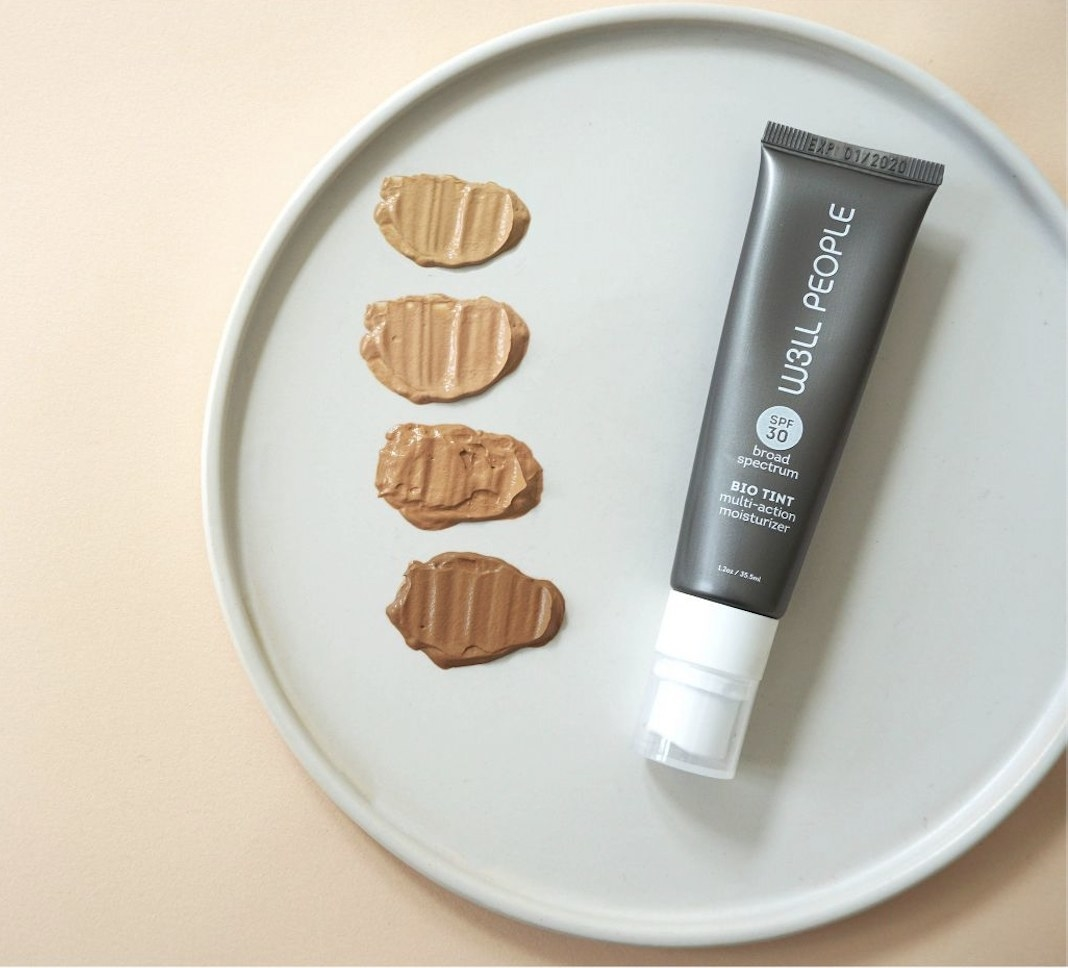four color swatches next to a foundation tube