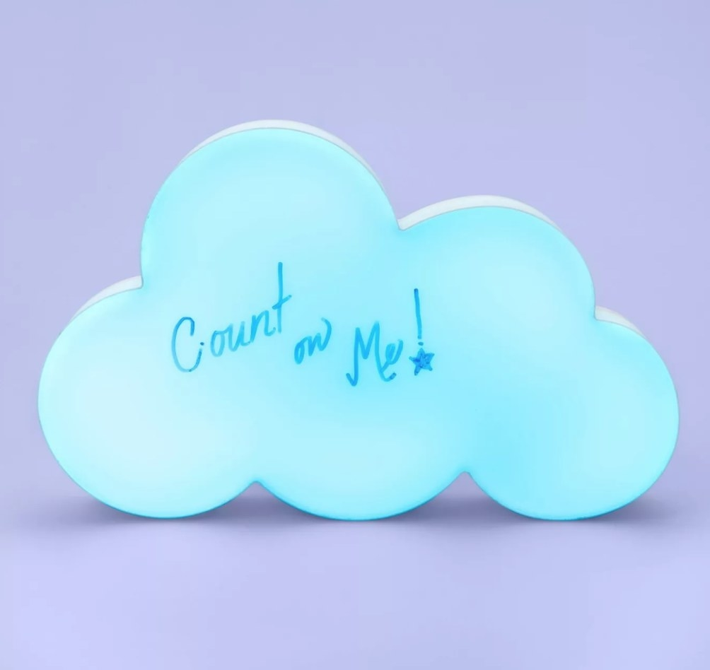 the cloud white board lit up with 'count on me' written across