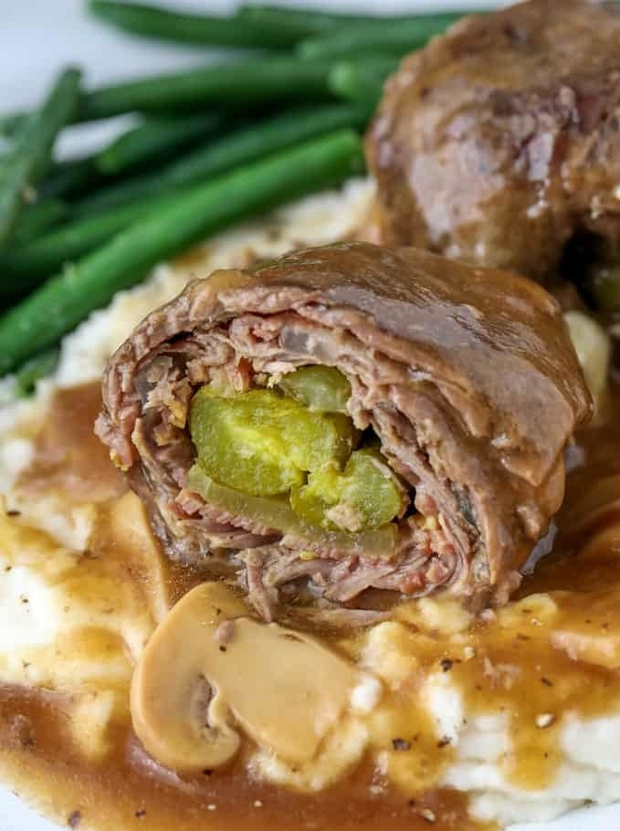 Beef rouladen stuffed with bacon, onion, and pickles.