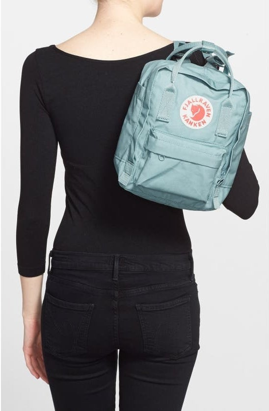 A model wearing the backpack in Sky Blue