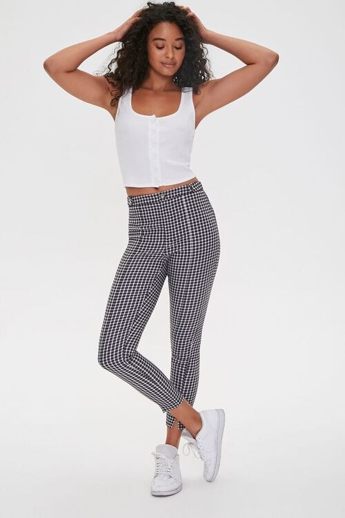 Model wearing black/white checkered pants
