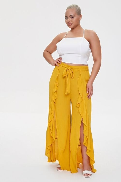 Model wearing tie-front mustard pants