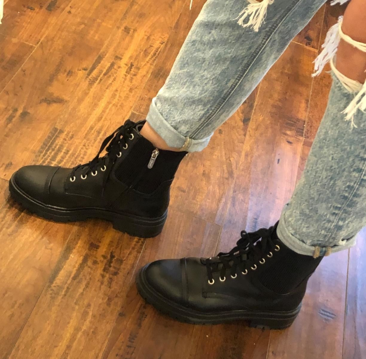 a reviewer wearing the combat boots