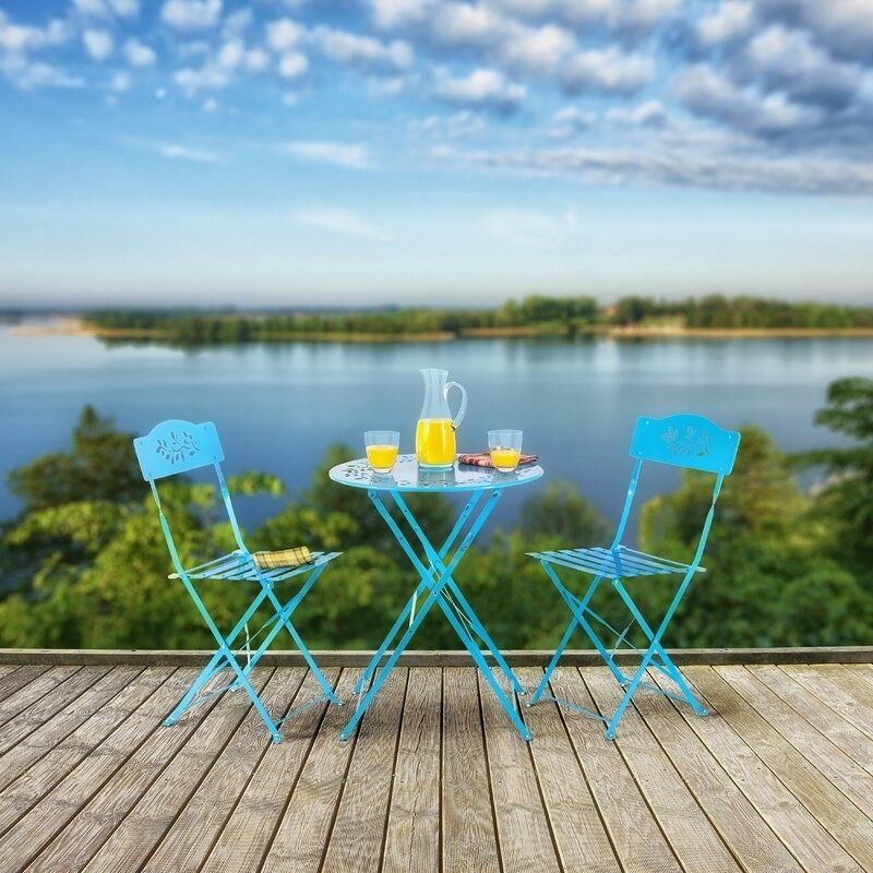 Blue metal bistro set with folding table and chairs