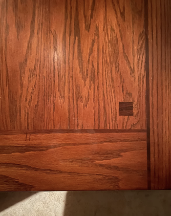 The same wooden surface completely clear of the stain