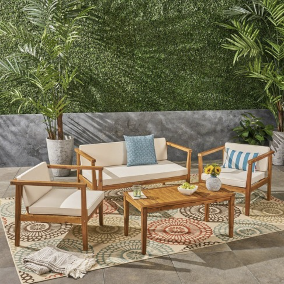wood patio set with white cushions