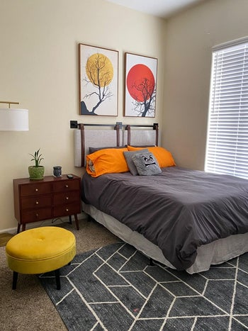 side view of a reviewer's gray headboard mounted to the wall