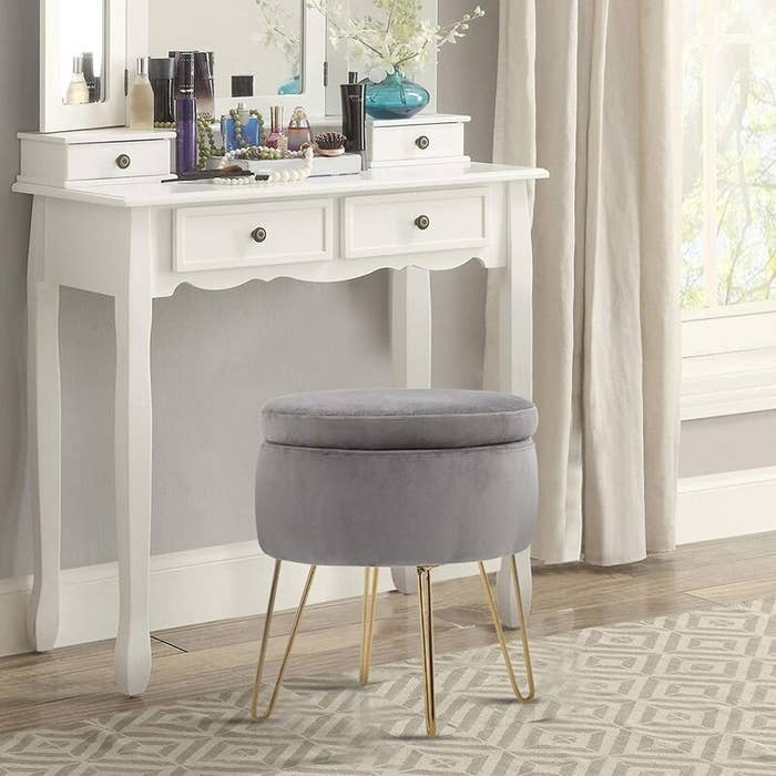 The storage ottoman in the color Gray