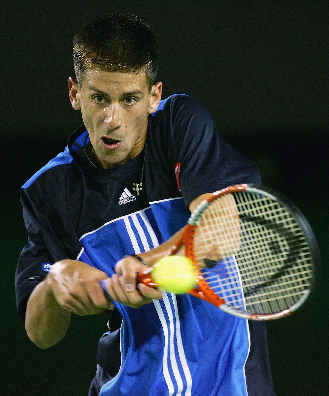 Young Novak hitting tennis ball.