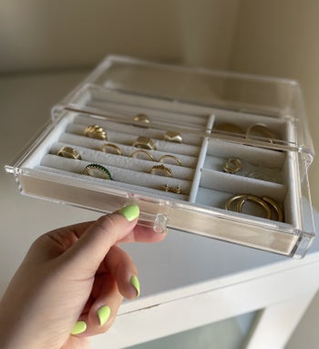 buzzfeed editor pulling out the top drawer which holds rings