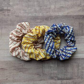 three retro mickey themed scrunchies