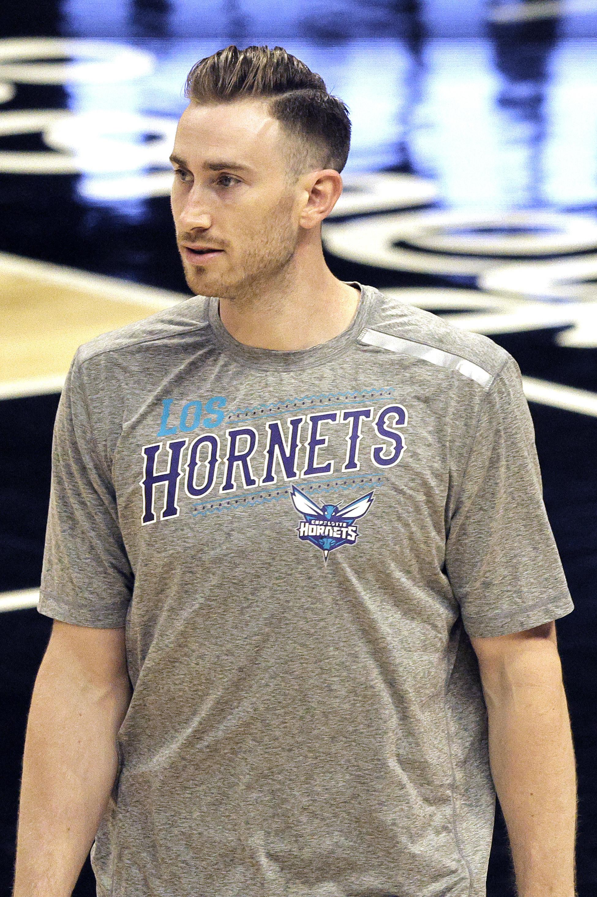 Gordon Hayward in Hornets shirt.