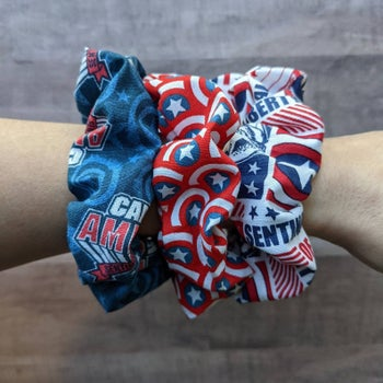 a model wearing three captain america inspired scrunchies