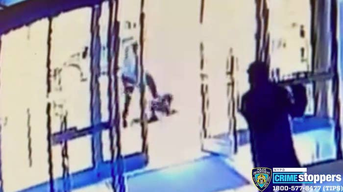 Surveillance footage shows a man with his leg raised