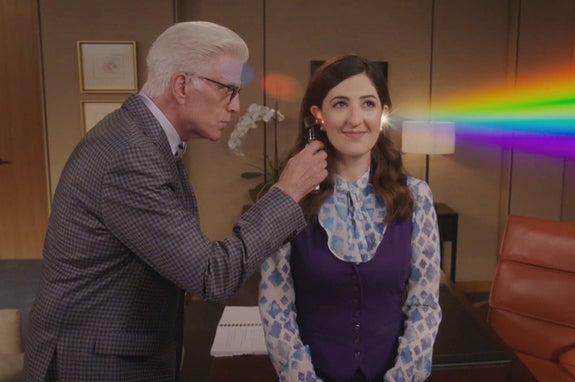michael from the good place looking into janet's ear and seeing a rainbow come out the other side