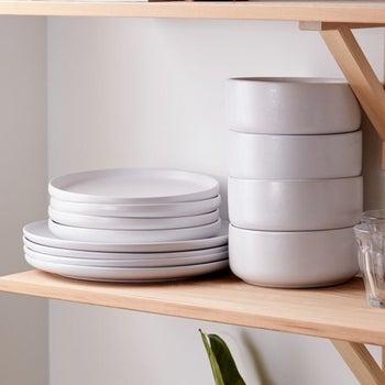 a white set stacked on a shelf