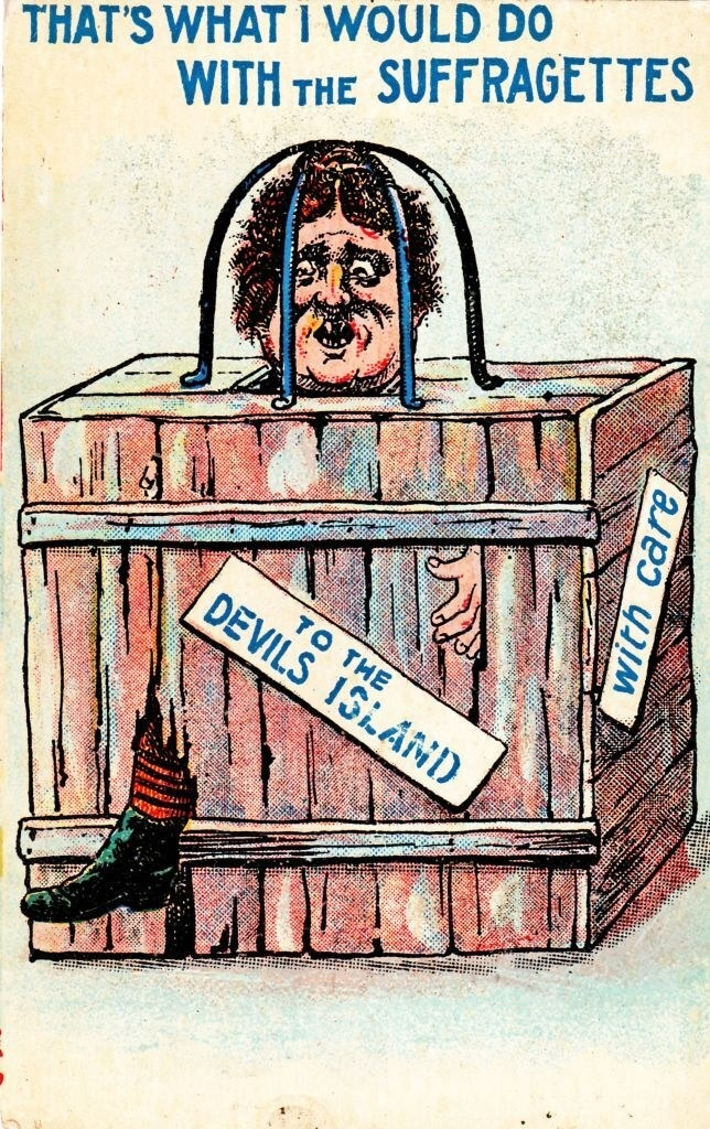 """A woman in a box being sent to """"Devils Island,"""" with the caption, """"That's What I Would Do With The Suffragettes"""""""